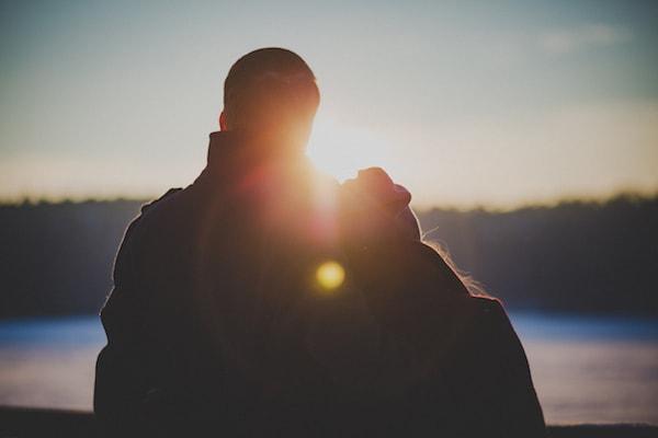 couple at lake watching sunset